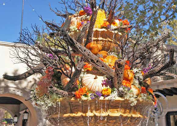 picture of a water fountain adorned with Outdoor Thanksgiving and Christmas Decorating ideas