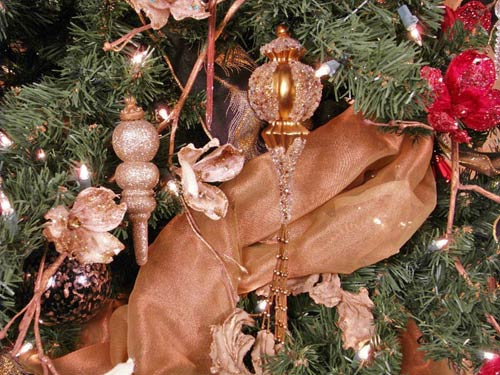 image of decorating a Christmas tree with ribbon